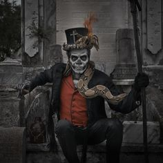 Papa Legba voodoo - Actually, this is an image of Baron Samedi. Papa usually appears as a old man walking with a cane. He wears a straw hat, smokes a pipe and usually has a dog with him. He stands at the crossroads and grants or denies permission to speak with the spirits. He is often associated with St Peter or St Anthony