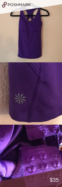 Athleta purple workout top/sports bra. Athleta purple workout top/sports bra. Great condition!  Smoke free and Pet free home.  Thanks for checking out my closet and let me know if you have any questions!  15% off 2 or more items when you bundle! If you like more than 1 item add them to a bundle! Athleta Tops