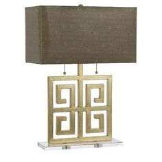 Metal and crystal table lamp with an open Greek key base and faux snakeskin shade.    Product: Table lampConstructio...