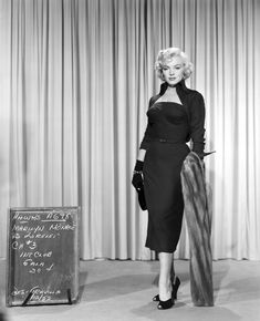 Marilyn Monroe in a wiggle dress and fur stole in GENTLEMEN PREFER BLONDES.