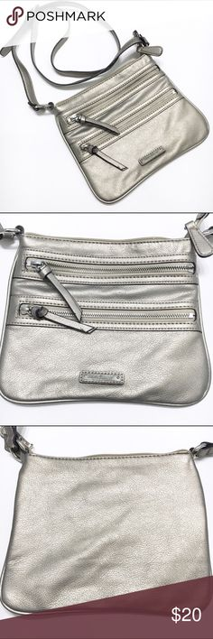 Host Pick Nine West crossbody purse Nine West small purse with adjustable crossbody strap. Metallic colored. Zipper closure on top and 2 zippered compartments on the front. Nine West Bags Crossbody Bags