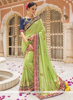 We are to breathe life into your aspirations and to make a mark in the world of style. Attract compliments by this green silk designer saree. The lovely embroidered, patch border, resham and zari work...