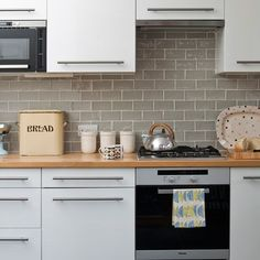 I adore the retro, vintage look of the grey tiles here.  They would go perfectly well in my purple gloss kitchen