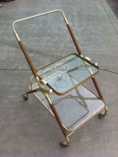 Italian Bar cart Cesare Lacca 1950's | From a unique collection of antique and modern bar carts at https://www.1stdibs.com/furniture/tables/bar-carts/