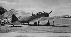 """Japanese bomber B5N2 «Kate"""" on the airfield parked in Rabaul"""