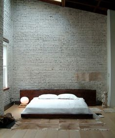Peaceful, rustic, minimalist bedroom with angled ceiling and brick walls ||  B L O O D A N D C H A M P A G N E . C O M:
