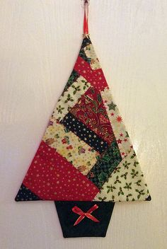 Scrappy fabric Christmas tree. Fantastic tutorial on http://bossymamma.blogspot.co.uk/