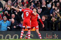 Time to celebrate: Jay Rodriguez joins Adam Lallana to mark Southampton's opening goal