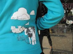i have this pattern, only on a leaf green scarf.  i saw this hoodie live in person in boston at the vegfest, and i totes should have bought it.