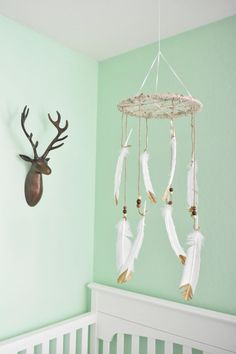 DIY love the Dream catcher crib mobile, deer head mount, white crib and mint walls in this woodland theme nursery. Could be gender neutral nursery, a boy nursery, or any baby nursery, so beautiful.