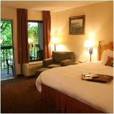 Hampton Inn Gatlinburg accommodations include a clean and fresh bed, free hot breakfast, WiFi, and access to our gym, pool and hot tub.