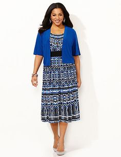 Create a night to remember with our beautiful short-sleeve jacket dress. The vibrantly colored jacket has an openfront to effortlessly showcase the scoopneck dress below. An allover tribal print covers the dress, while the solid empire band emphasizes your waist. Pintucking at the neckline. Jacket has bust darts and smooth stretch fabric. Dress features a discrete zip back closure. Catherines dresses are expertly designed for the plus size woman. catherines.com