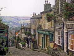 visitheworld: The beautiful village of Haworth, where the Brontë sisters lived, Yorkshire, England (by JauntyJane). enchantedengland: Reason Number to visit Yorkshire. Yorkshire England, West Yorkshire, England Uk, Northern England, Travel England, Great Places, Places To See, Amazing Places, Beautiful World