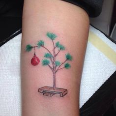 Rep your favorite holiday movie with this Charlie Brown Christmas tattoo.