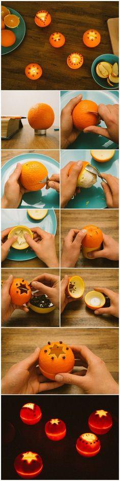 Des bougies dans une orange pour une déco de Noël parfumée et naturelle