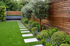 Low-maintenance yet full of interest with glossy green shrubs, clipped box balls silvery green olive trees. Designed by Tom Howard, this is… - Alles über den Garten Back Garden Design, Modern Garden Design, Backyard Garden Design, Garden Landscaping, Backyard Designs, Landscaping Ideas, Pergola Designs, Modern Landscaping, Terrace Garden
