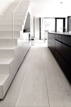 Scandinavian kitchen with wide plank Dinesen floor