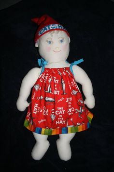 Samara's handmade doll with Down Syndrome and removable hearing aids. Turn the hat around, and she goes to sleep.