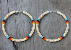 Pictured are a pair of tan (off white) 3 inch peyote stitch hoop earrings. The hoops are silver and nickel free. Please feel free to contact me if you have questions or even special color or design requests. $42.00 http://www.etsy.com/shop/eleumne