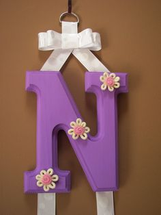 Personalized lavender hair bow holder with adorable rope flower accents.