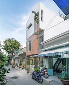 green concept adds a patterned brick façade to house 45 in vietnam