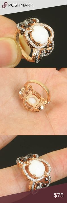 Rose Gold Flower Design Ring Size 7.5 Rose Gold over .925 Sterling Silver.  White Center surrounded by clear and black stones. Gorgeous Ring.  Is shaped to fit around the finger.  Very comfortable and light weight. Designed by a master craftsman.  Beauty that won't break the bank!! NEW IN PACKAGE Jewelry Rings