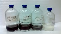 Three sample bottels with cultures of hydrogen sulfide-producing bacteria (fracking)