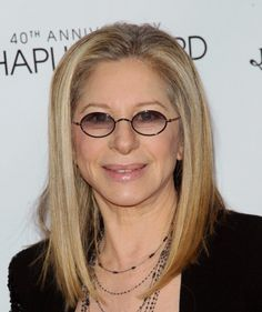 Barbra Streisand !!  Why would God give such a great singing voice to such a freaking clueless idiot!!