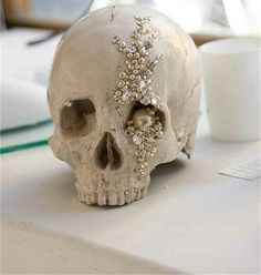 Jeweled Skull... buy a cheap skull from Michaels or Hobby Lobby, cut off bottom jaw (or not), paint with flat paint (or not), and bejewel/crystalize to your heart's content!