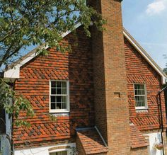 Tudor Roof Tile adds style and value with vertical hanging tiles