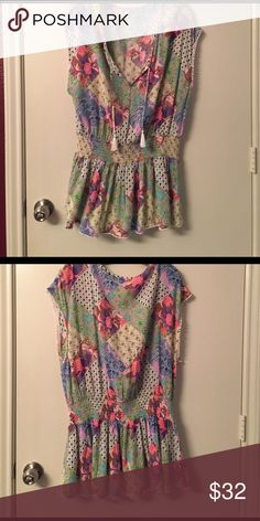 NWOT Victoria's Secret Summer Sundress Cover Up From 2016 beach/summer collection. Looks like a romper but it actually a sundress. Perfect cover up. Has elastic at the waist and drawstring at the neck. Never worn. Cute and flirty with pretty colorful pattern with green, white, pink, blue, and purple. Tiny pom-pom fringe. Great for spring break! Victoria's Secret Swim Coverups