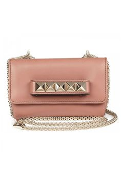 """It's called the Garavani Vavavoom bag. Need we say more? Well, ok then – this sugary sweet hue never looked so cool than off-set with punky studding.  £1,200, [link url=""""http://www.valentino.com""""][b]www.valentino.com[/b][/link]"""