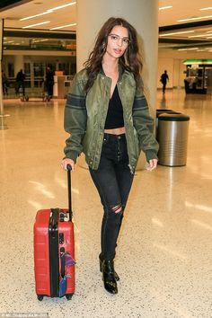 Can be deceiving: When she walked through JFK airport, Emily certainly looked ready to take on the fall temperatures.