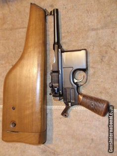 """C96 BROOMHANDLE MAUSER BOLO. SHANGHAI POLICE CONTRACT. EXTREMELY RARE!!! 3 3/4"""" BARREL. 7.63MM. ORIGINAL GERMAN MAUSER CONTRACTUAL PRODUCTION RUN FOR THE """"SHANGHAI POLICE"""". THE CHINESE CHARACTERS WERE INSCRIBED DURING PRODUCTION AT THE MAUSER FACTORY. THE CHINESE CHARACTERS TRANSLATE: """"WHO CITY PUBLIC SECURITY BUREAU"""". WHO CITY WAS ANOTHER NAME FOR SHANGHAI."""