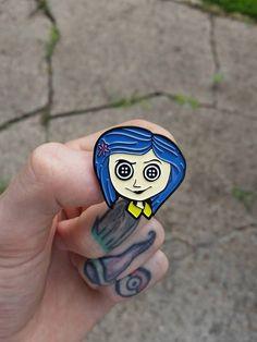 CORALINE Enamel Pin / Lapel Pin by WIZARDOFBARGE on Etsy https://www.etsy.com/listing/278344970/coraline-enamel-pin-lapel-pin