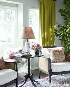 kensington cane chairs. Blue walls and green curtains. Mixing floral patterns