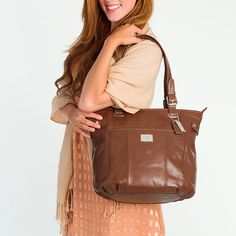"""Bella Beautiful Bella is crafted in rich leather, making it the perfect daily statement bag and suitable for every occasion.  •  Genuine leather •  15"""" L, 13"""" H, 4.25"""" W •  Handles with 10.25"""" drop •  Exterior pocket fits any Grace Adele Clutch"""