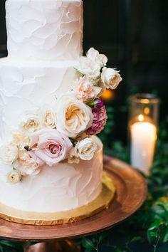 Rustic wedding cake topped with flowers: http://www.stylemepretty.com/2017/05/10/dusty-blue-crimson-austin-wedding/ Photography: Ashley Bosnick - http://ashleybosnick.com/