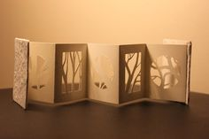 Miniature book/paper cut out branches by ~izibel1 on deviantART. Produce something like this before for a project. Nothing is ever original anymore :/
