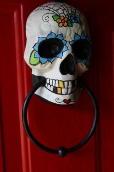 sugar skull day of the dead doorknocker hand painted by dalaimomma (original pin) EASY AS PIE DIY -- easy halloween diy project.  this is a doorknocker you can get at the dollar tree painted with acrylic paints so you could do it on your own for way way cheaper than what she's charging and would be easy to customize to your own holiday decor