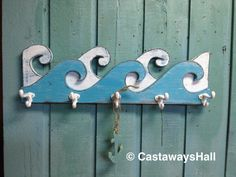 Waves Coat Rack Hook Rack Sign Wall Beach House Nautical Decor by CastawaysHall - 25 Inches  Now my popular waves come with hooks to make it into a functional piece of art. Catch a wave with this weathered white and turquoise ocean waves coat rack for your beach house style decor. Great
