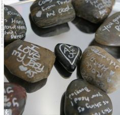 Wedding Stones. Have your guests sign the stones.  Keep them in a vase or frame.  We used the stones as part of our rustic table decorations.  A couple of paint pens were provided for each table too so guests could write on them at their leisure during the reception.