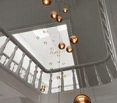 Un escalier demi tournant embellit vos intérieurs modernes