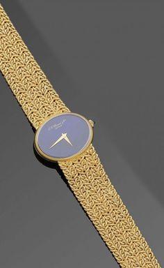 Damenarmbanduhr von Chopard aus den 80er Jahren Gelbgold, gest. 750. Elipsenförmiges Uhrengehäuse. — Schmuck