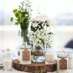 Ivory candles with kraft tags as bonbonnieres