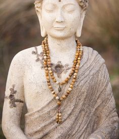 Om Houm Namah. My inner and outer worlds mesh perfectly.  This soothing 108 bead stretch mala features beautiful high grade Picture Jasper gemstones, a Tibetan carved bone bead and an antique brass reversible Buddha head drop charm for a wonderfully neutral look that goes with everything. It hangs beautifully around the neck or wraps around the wrist several times for a bolder style. Long malas offer four times the healing vibration. For men and women.  Known as the supreme nurturer…