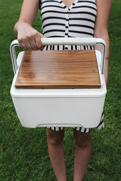 make over a cooler using spray paint and faux wood paper...this would be great for Jesse's ugly lunchbox!