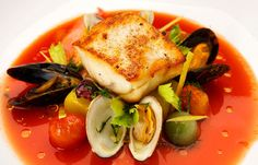 """Summer Wedding: Entrée - Roasted Bass Aqua Pazza, which translates literally to """"crazy water"""" in Italian, is an effortless, flavorful dish made with olive oil and cherry tomatoes."""