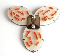 Brooch by Zoe Arnold Mother of pearl gambling chips, antique coral, pearls, oxidised silver, tin type photograph.