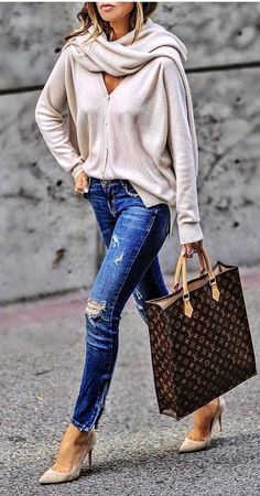 #spring #outfits women wearing gray cardigan and blue distressed jeans while holding black Louis Vuitton Monogram leather tote bag. Pic by @rome_fashion_style